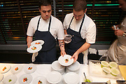 New York, NY - October 26, 2014: Cooks from Batard prepare small dishes at the opening reception for the International Chefs Congress, hosted by StarChefs at Urbo. <br /> <br /> CREDIT: Clay Williams for StarChefs.<br /> <br /> © Clay Williams / claywilliamsphoto.com