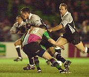 Photo Peter Spurrier<br />04/02/2003<br />Betfair Challenge Rugby - NEC  Harlequins vThe Sharks<br />Sharks centre, Andre Snyman, is tackled by Harlequin's Henry Barrett, , The Stoop Memorial Ground, [Mandatory Credit: Peter Spurrier/Intersport Images],