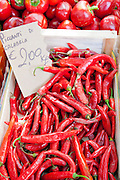 Red chillis,  Piccanti di Calabria, on sale at weekly street market in Panzano-in-Chianti, Tuscany, Italy