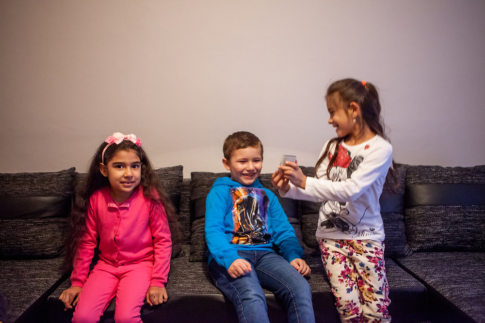 Aneta, Richard and Nikola (from left) playing and having fun during a meeting with volunteers and mothers with their children for consultation and data collection regarding school enrolments in Ostrava. The meeting was in a volunteers flat.