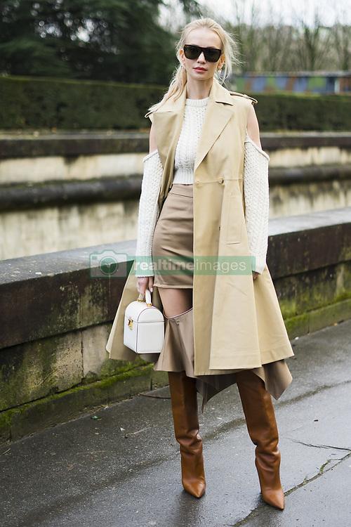 March 4, 2018 - Paris, France - Tatiana Korsakova wears a sleeveless beige trench coat, brown boots, a bag, a white wool off shoulder top, outside Valentino, during Paris Fashion Week Womenswear Fall/Winter 2018/2019, on March 4, 2018 in Paris, France. (Credit Image: © Nataliya Petrova/NurPhoto via ZUMA Press)