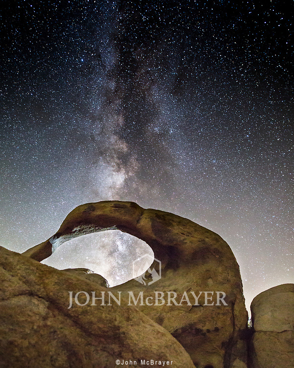 The Milkyway a the Mobius Rock.  Located in the Eastern Sierras, this is a popular spot for photgtaphers, which is why I was pleasantly surprised to have it all to myself.  The rock is partially illuminated by the lights from a large group leaving the area. © John McBrayer