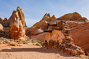 """1965 movie set remains from """"The Professionals"""" in Valley of Fire State Park, near Moapa Valley, Nevada, USA. Starting more than 150 million years ago, great shifting sand dunes during the age of dinosaurs were compressed, uplifting, faulted, and eroded to form the park's fiery red sandstone formations."""
