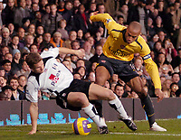 Photo: Ed Godden.<br /> Fulham v Arsenal. The Barclays Premiership. 29/11/2006.<br /> Fulham's Moritz Voltz (L), tussles with Thierry Henry.