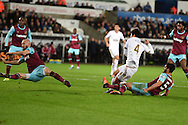 a shot at goal from Ki Sung-Yueng of Swansea city appears to hit the arm and gets blocked by James Collins of West Ham (far left) but referee Lee Mason does not give a penalty. Barclays Premier league match, Swansea city v West Ham Utd at the Liberty Stadium in Swansea, South Wales  on Sunday 20th December 2015.<br /> pic by  Andrew Orchard, Andrew Orchard sports photography.