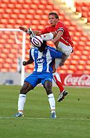 Photo: Sportsbeat Images<br />Barnsley v Wigan Athletic. Pre Season Friendly. 31/07/2007.<br />Barnsley's Brianm Howard (R) beats Julius Agahowa in the air