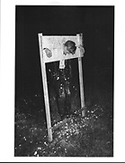 Gatecrasher, Rob Collins in stocks covered in eggs during the Magdalene May Ball. Cambridge. 15 June 1983.