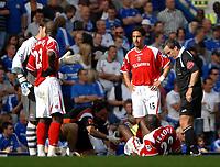Photo: Ed Godden.<br />Chelsea v Charlton Athletic. The Barclays Premiership. 09/09/2006. Charlton's Djimi Traore lies injured on the floor.