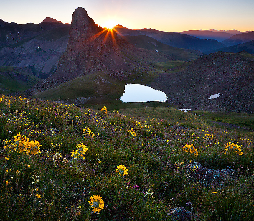A new day dawns with jubilant alpine sunflowers eagerly looking on. This remote and untrailed wilderness jewell is hidden atop the high reaches of the San Juan Mountains in Southwest Colorado. The brilliant light forever frozen in this image lasts for only about 15 seconds as the sun just begins to peer over the horizon. I had taken a good photograph here the previous morning, but thought I could improve on the composition. So I extended my stay another 24 hours in order to buy another 15 seconds of heavenly light.