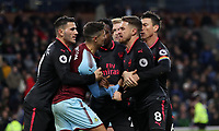 Football - 2017 / 2018 Premier League - Burnley vs. Arsenal<br /> <br /> Aaron Ramsey of Arsenal wins a penalty and Matthew Lowton of Burnley complains at Turf Moor.<br /> <br /> COLORSPORT/LYNNE CAMERON