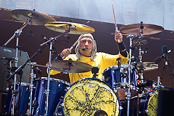 © licensed to London News Pictures . 30/06/2012 . Manchester , UK . Stone Roses drummer Reni with The Stone Roses on stage at Heaton Park during the band's comeback event . Photo credit : Joel Goodman/LNP