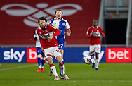 Blackburn Rovers defender Lewis Travis (27) chases Middlesbrough midfielder Jonathan Howson (16)  during the EFL Sky Bet Championship match between Middlesbrough and Blackburn Rovers at the Riverside Stadium, Middlesbrough, England on 24 January 2021.