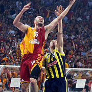 Galatasaray's Evren BUKER (L) and Fenerbahce Ulker's Sarunas JASIKEVICIUS (R) during their Turkish Basketball league Play Off Final fourth leg match Galatasaray between Fenerbahce Ulker at the Abdi Ipekci Arena in Istanbul Turkey on Saturday 11 June 2011. Photo by TURKPIX