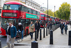 London, October 31 2017. Buses queue on Whitehall in London seeming to be going nowhere fast as their engines idle. London's pollution levels are above EU targets and Mayor Sadie Khan has introduced the city's T-charge in an attempt to get older, more polluting vehicles off the capital's streets. © Paul Davey