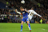 Cardiff City's Joe Ralls (l) is fouled by Hull City's Sone Aluko. Skybet football league championship match, Cardiff city v Hull city at the Cardiff city stadium in Cardiff, South Wales on Tuesday 15th Sept 2015.<br /> pic by Carl Robertson, Andrew Orchard sports photography.
