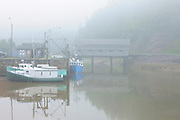 FIshing boats  in fog and Vaughn Creek # 1 Irish River Covered Bridge<br /> Saint Martins<br /> New Brunswick<br /> Canada
