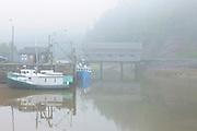 FIshing boats  in fog and Vaughn Creek # 1 Irish River Covered Bridge<br /> Saint Martins<br /> New Brunswick<br /> Canada