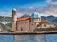 Pictures images and photos of Our Lady of the Rocks Island and church and its church which was renovated in 1722. The church contains 68 paintings by Tripo Kokolja, a famous 17th-century baroque artist from Perast. His most important painting, ten meters long, is The Death of the Virgin. Our Lady of the Rocks is one of the two islets off the coast of Perast in the Bay of Kotor, Montenegro.  It is an artificial island created by bulwark of rocks and by sinking old and seized ships loaded with rocks. According to legend, the islet was made over the centuries by local seamen who kept an ancient oath after finding the icon of Madonna and Child on the rock in the sea. Kotor Bay Montenegro. .<br /> <br /> Visit our MONTENEGRO HISTORIC PLAXES PHOTO COLLECTIONS for more   photos  to download or buy as prints https://funkystock.photoshelter.com/gallery-collection/Pictures-Images-of-Montenegro-Photos-of-Montenegros-Historic-Landmark-Sites/C0000AG8SdQ.sYLU