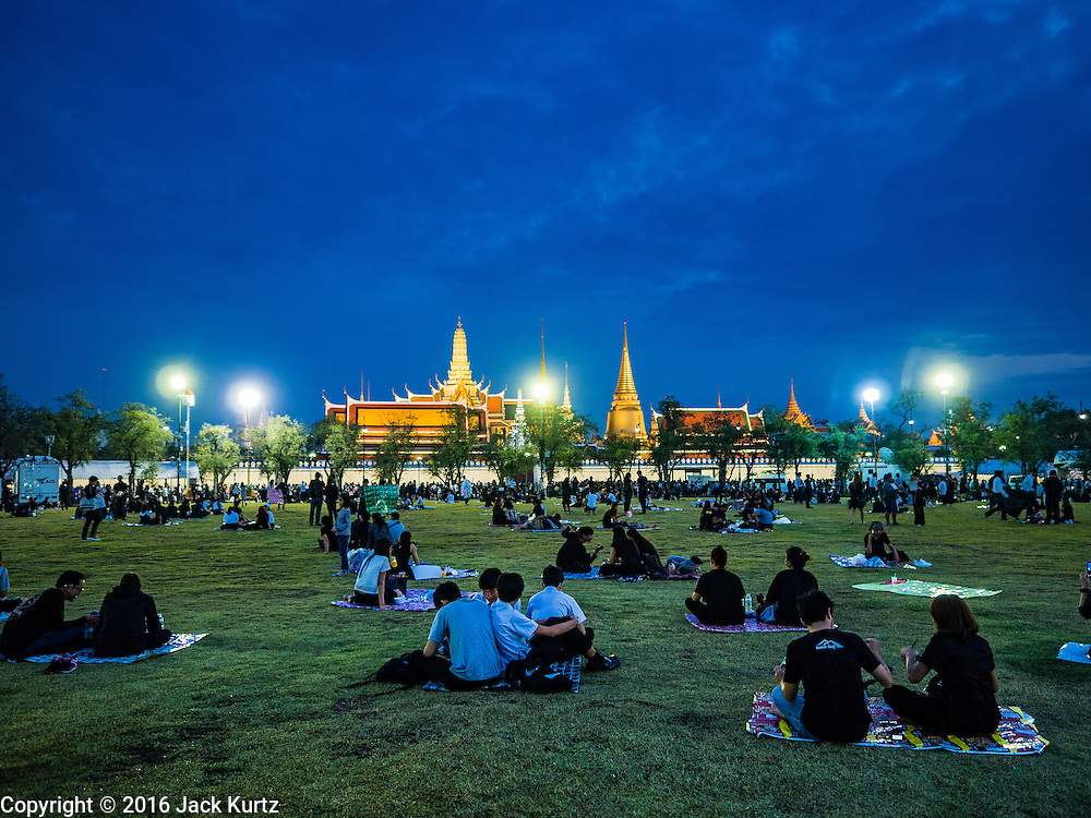 17 OCTOBER 2016 - BANGKOK, THAILAND: Mourners gather on Sanam Luang, across the street from the Grand Palace in Bangkok where the late Thai King Bhumibol Adulyadej lies in state. He was 88 at the time of his death. His death comes after a period of failing health. Bhumibol Adulyadej, was born in Cambridge, MA, on 5 December 1927. He was the ninth monarch of Thailand from the Chakri Dynasty and is also known as Rama IX. He became King on June 9, 1946 and served as King of Thailand for 70 years, 126 days. He was, at the time of his death, the world's longest-serving head of state and the longest-reigning monarch in Thai history.        PHOTO BY JACK KURTZ