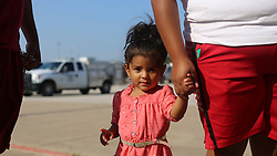 August 29, 2017 - Fort Worth, TX, USA - Two-year-old Belinda clings tight to her mother, Blanca Lopez as her family makes their way into Wilkerson-Greines. American Red Cross volunteers are preparing Wilkerson-Greines Activity Center in south Fort Worth for potential evacuees of Hurricane Harvey. (Credit Image: © Jared L. Christopher/TNS via ZUMA Wire)