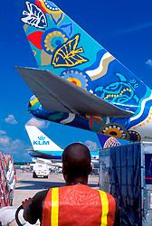 Baggage Handler at International Terminal Drives Vehicle To Airplane to Load Luggage at  George Bush Intercontinental Airport