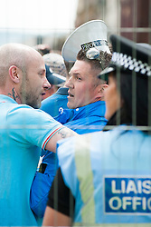 The English Defence League (EDL) return to Sheffield to lay flowers at Sheffield War Memorial which is fenced off to stop counter protesters occupying the whole of Barkers Pool. EDL leader Tommy Robinson leaves the fenced area having laid his tribute<br /> <br /> 8 June 2013<br /> Image © Paul David Drabble<br /> www.pauldaviddrabble.co.uk