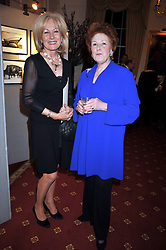 Left to right, LADY ANNUNCIATA ASQUITH and LADY ELIZABETH ANSON at an exhibition of photographs by Edgar Astaire held at The Royal Hospital Chelsea, London on 24th April 2009.