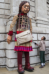 Little Amal, a giant puppet of a Syrian refugee girl fleeing conflict, stands against St Paul's Cathedral on 23rd October 2021 in London, United Kingdom. The 3.5-metre puppet, which is nearing the end of an 8,000km journey from the Turkish-Syrian border to Manchester in support of refugees, climbed the steps of St Paul's Cathedral to present a wood carving of a ship at sea from St Paul's birthplace at Tarsus in Turkey to the dean.