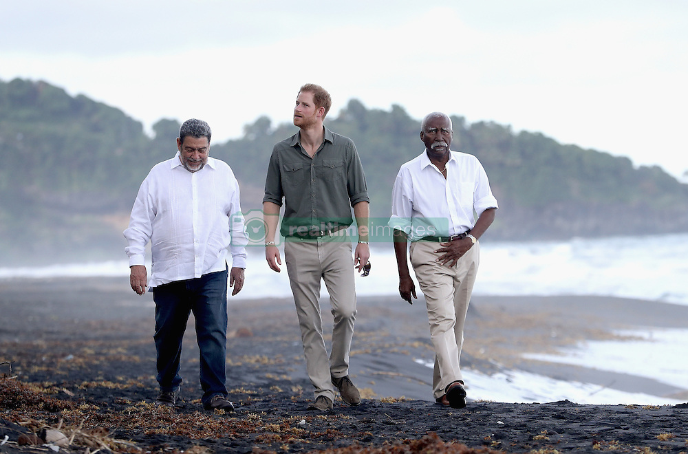 Prince Harry with Prime Minister Ralph Gonsalves (left) and Govenor General Frederick Ballantyne at a Turtle Conservation Project at Colonarie Beach, Saint Vincent and the Grenadines, during the second leg of his Caribbean tour.