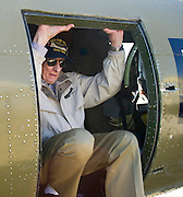 """John """"Lucky"""" Luckadoo, a World War II bomber pilot, climbs out of a Boeing B-17G Flying Fortress outside the Frontiers of Flight Museum in Dallas on Wednesday, March 20, 2013. (Cooper Neill/The Dallas Morning News)"""
