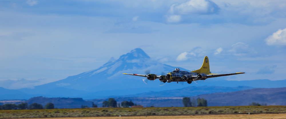 """Brent Conner flies Tillamook Air Museum's B17 """"Chuckie"""" past Mt. Hood at the Airshow of the Cascades."""