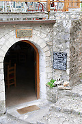 The entrance to a restaurant with the menu on a chalk board outside. Pocitelj historic Muslim and Christian village near Mostar. Federation Bosne i Hercegovine. Bosnia Herzegovina, Europe.