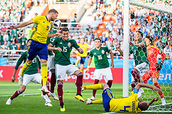 June 27, 2018 - Yekaterinburg, RUSSIA - MARCUS BERG and ANDREAS GRANQVIST of Sweden in action against HECTOR MORENO of Mexico during the FIFA World Cup group stage match between Mexico and Sweden in Yekaterinburg. (Credit Image: © Joel Marklund/Bildbyran via ZUMA Press)