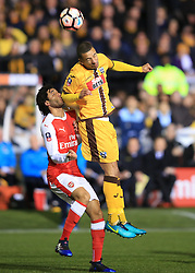 20 February 2017 - The FA Cup - (5th Round) - Sutton United v Arsenal - Craig Eastmond of Sutton United in action with Mohamed Elneny of Arsenal - Photo: Marc Atkins / Offside.