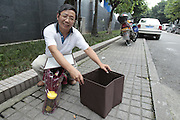 CHONGQING, CHINA - JUNE 12: (CHINA OUT) <br /> <br /> Convenient Foldable Emergency Toilet<br /> <br /> Li Shuqing assembles the foldable emergency toilet invented by himself on June 12, 2014 in Chongqing province of China. Professor of Chongqing University Li Shuqing has invented a foldable emergency toilet made up of a storage box, a disposable bag and a raincoat which weighs 2.5 kg in total with the on line price of 168 Yuan. <br /> ©Exclusivepix