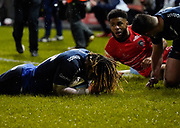 Sale Sharks wing Marland Yarde dives over for his second try during a Gallagher Premiership Rugby Union match Sale Sharks -V- Leicester Tigers, won by Sale 36-3 Friday, Feb. 21, 2020, in Eccles, United Kingdom. (Steve Flynn/Image of Sport via AP)