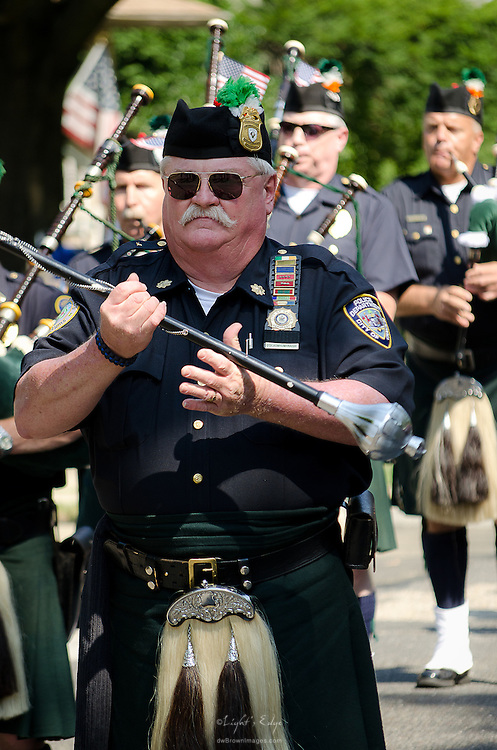 Enter the bagpipe brigade at Pitman's Fourth of July parade.