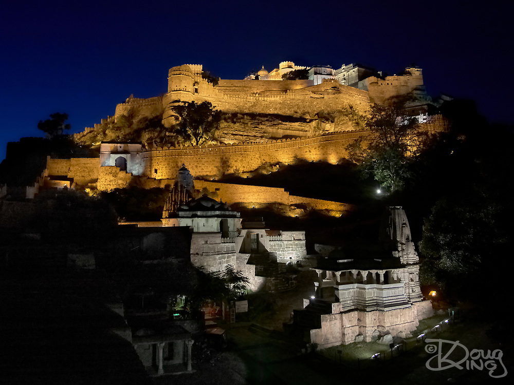 Every evening the fortifications and temples of World Heritage Kumbhalgarh Hill Fort are spectacularly illuminated for a few minutes.<br /> Rajasthan India.