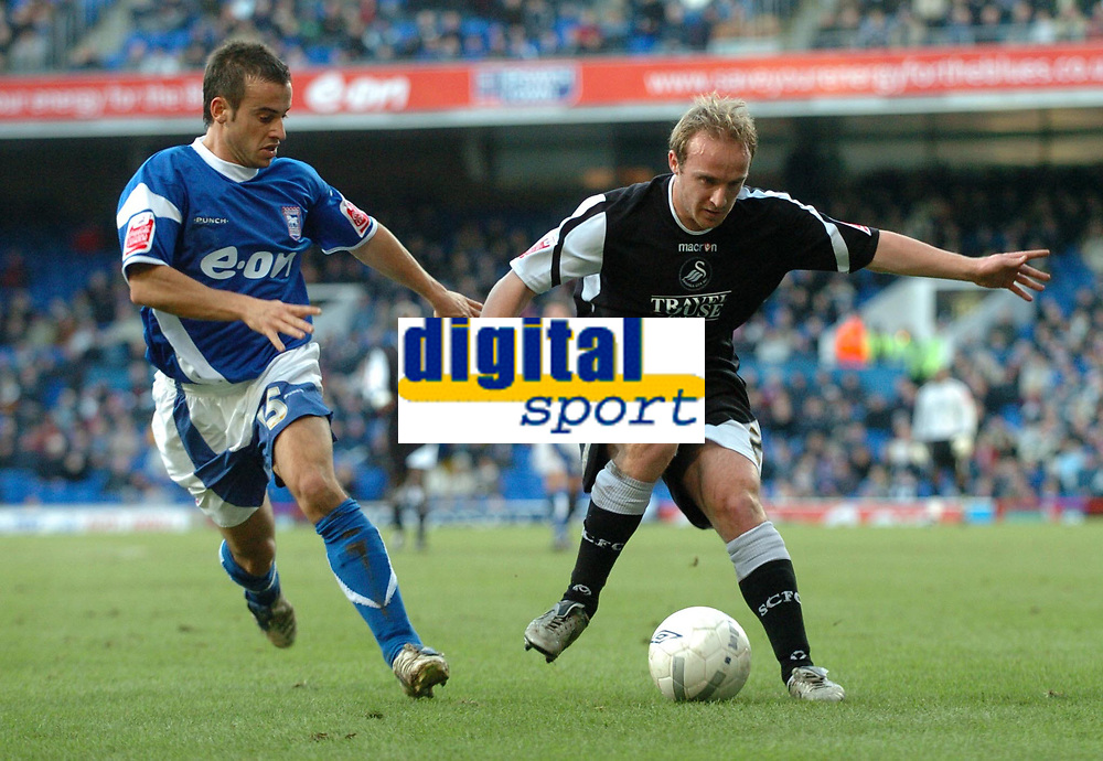Photo: Ashley Pickering.<br />Ipswich Town v Swansea City. The FA Cup. 27/01/2007.<br />Swansea's Thomas Butler (R) takes on Ipswich's Sito Castro