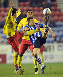 Watford's Fernando Forestieri challenges Wigan's Jason Pearce  - Photo mandatory by-line: Richard Martin-Roberts/JMP - Mobile: 07966 386802 - 17/03/2015 - SPORT - Football - Wigan - DW Stadium - Wigan Athletic  v Watford - Sky Bet Championship