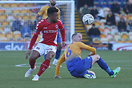 Neal Bishop of Mansfield Town (6) and Nicky Ajose of Charlton Athletic (25) challenge for the ball during the The FA Cup match between Mansfield Town and Charlton Athletic at the One Call Stadium, Mansfield, England on 11 November 2018.