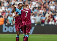 Football - 2019 / 2020 Premier League - West Ham United vs. Norwich <br /> <br /> West Ham goalscorers Sebastien Haller (West Ham United) and Andriy Yarmolenko (West Ham United) congratulate each other at the London Stadium<br /> <br /> COLORSPORT/DANIEL BEARHAM