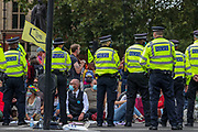 Police officers stand by at Parliament Square during an Extinction Rebellion climate change protest in London, Tuesday, Sept 1, 2020. (VXP Photo/ Vudi Xhymshiti)