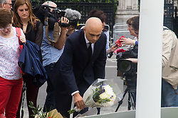 Parliament Square, Westminster, London, June 17th 2016. Following the murder of Jo Cox MP friends and members of the public lay flowers, light candles and leave notes of condolence and love in Parliament Square, opposite the House of Commons. PICTURED: Business Secretary Sajid Javid lays flowers in Parliament Square.