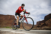 SHOT 5/7/16 8:46:48 AM - Moab is a city in Grand County, in eastern Utah, in the western United States. Moab attracts a large number of tourists every year, mostly visitors to the nearby Arches and Canyonlands National Parks. The town is a popular base for mountain bikers and motorized offload enthusiasts who ride the extensive network of trails in the area. Includes images of Scenic Byway 128, Fisher Towers and downtown Moab. (Photo by Marc Piscotty / © 2016)