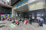 Buddhist members of the Extinction Rebellion environmental activist group sits in front of Barclays bank in Picadilly circus in central London on Wednesday, Sept 2, 2020. Barclays is the biggest European financier of fossil fuel companies and XR is demanding that it stops financing fossil fuel projects. (VXP Photo/ Vudi Xhymshiti)
