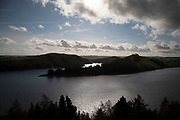 Llyn Clywedog reservoir in Wales, United Kingdom. The Clywedog reservoir near Llanidloes, Wales. Completed in 1967, the reservoir supplies water to Birmingham and the English Midlands by river regulation and to mitigate flooding in the lower Severn by storing excess winter rainfall.