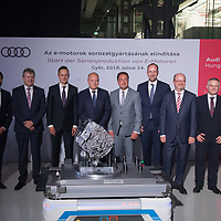 Guest pose for photographers with the first products at the opening ceremony of the E-Engine production start of electric engines at the Audi car factory in Gyor (about 120 km West of Budapest), Hungary on July 24, 2018. ATTILA VOLGYI