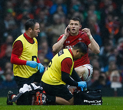 Dan Biggar of Wales receives medical attention <br /> <br /> Photographer Simon King/Replay Images<br /> <br /> Six Nations Round 5 - Wales v Ireland - Saturday 16th March 2019 - Principality Stadium - Cardiff<br /> <br /> World Copyright © Replay Images . All rights reserved. info@replayimages.co.uk - http://replayimages.co.uk
