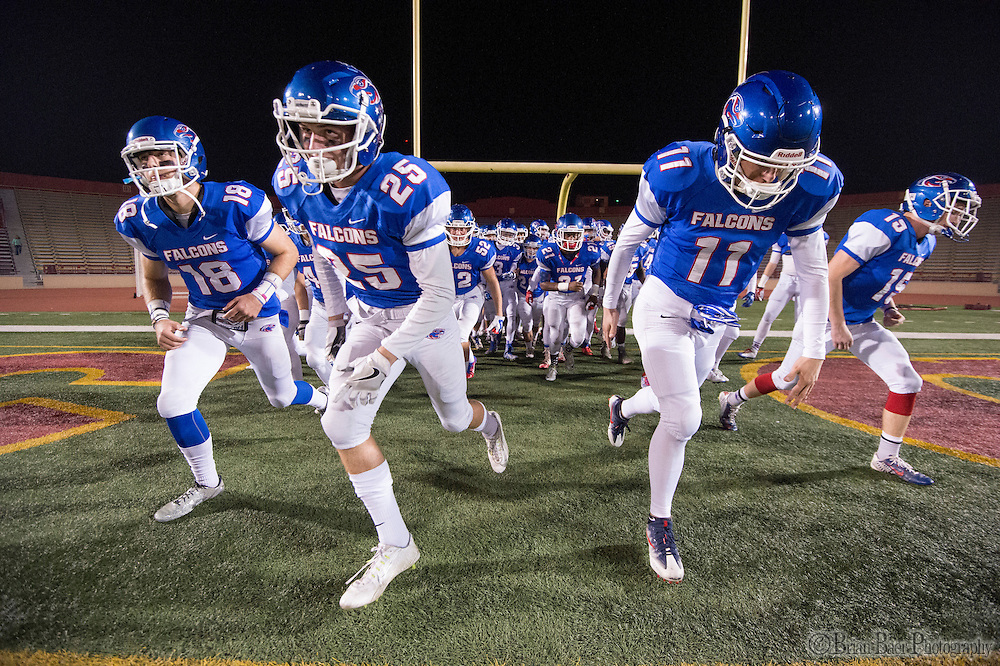 The Christian Brothers Falcons come on the to the field before the Sac-Joaquin Section Division I football playoff game between the Christian Brothers Falcons and Cordova Lancers at Huges Stadium,  Friday Nov 11, 2016.<br /> photo by Brian Baer